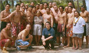 Kumuhula Sissy Kaio and the men of her Halau