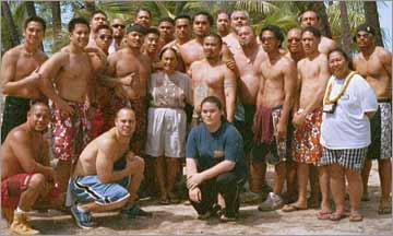 Kumuhula Sissy Kaio and the men of her Halau