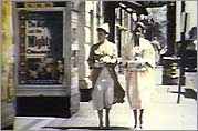 Two women walking down Main street