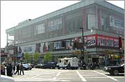 Commercial establishments on 125th Street, located in Harlem's Empowerment Zone circa 2003.