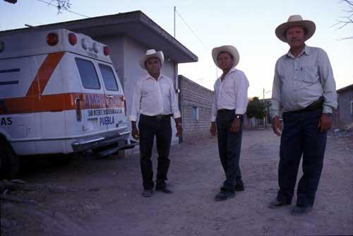 Manuel Garcia, Juan Herrera and Efigenio Leon stand near an ambulance which they purchased in Newburgh, New York and brought to their town in Southern Mexico.