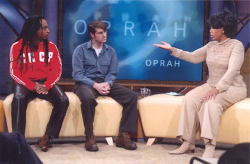 Filmmakers Marco Williams and Whitney Dow with Oprah Winfrey (2002)