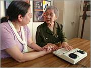 Gladys Wong receives training on the use of her TTY modem.