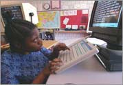 Latoya Nesmith uses a keyboard that mitigates her limited dexterity to complete her classroom assignments