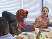 Madina Ali Yunye eating dinner with her American host family in Massachusetts