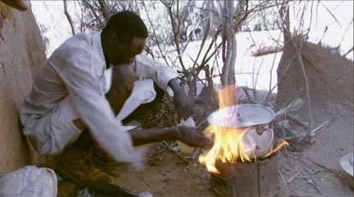 Lost Boys of Sudan - Santino Majok Chuor preparing a meal at the Kakuma Refugee Camp, Kenya.