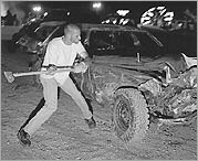 Smashing a car with an axe at a derby