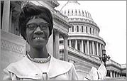 Shirley Chisholm with the U.S. Capitol building in the background