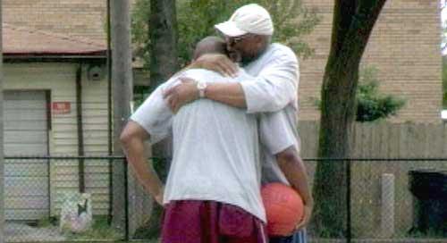 Mel Davis embraces son Mawuli.