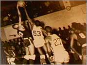Mel, left, in a Dunbar Vocational High School basketball game.