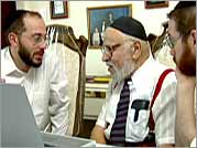 Menachem's father-in-law, Chaim Federman, with his two grandsons