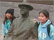 Hobart Shakespeareans pose next to FDR statue