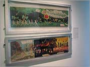 Two Darger paintings on view in the galleries of the American Folk Art Museum.