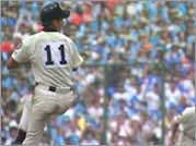 A pitcher winds up at the National High School Baseball Championship at Koshien Stadium in Osaka