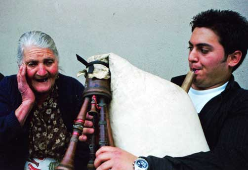 Lomax: Musician playing a traditional song on the bagpipe