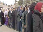Iraqis line up to cast their vote in the January 2005 elections.