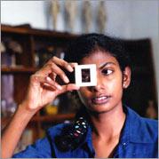 No More Tears Sister - Sharika looks into a slide.