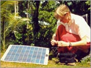 The Tailenders - Filmmaker Adele Horne sets up a solar power generator that will charge her camera's batteries in the Solomon Islands, where most villages are without electricity. Photo credit: Rebecca Baron.