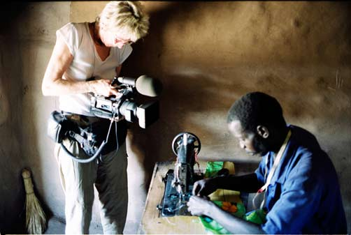 Joan Churchill films Abdulkadir Ali Yunye at Kakuma Refugee Camp, Kenya. Credit: Alan Barker