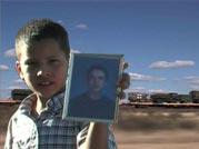 Esequiel Hernandez' nephew holding a photo of Esequiel
