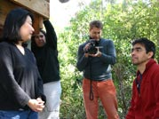 Renee Tajima-Peña (left) talks to her husband Armando Peña while the crew keeps working on the set of Calavera Highway.