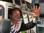 Kazuhiko Yamauchi waves from his campaign car.