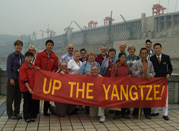 Film participants and tourists hold an Up The Yangtze banner at the Three Gorges Dam. (left-right: Yu Shui/Cindy. Chen Bo Yu/Jerry, Yang Zhibi, Yu Ting Jun, & river guide Campbell He Ping.)