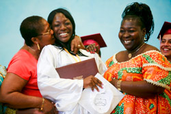 Bronx Princess- Rocky Otoo, 17, center, stands with her mother