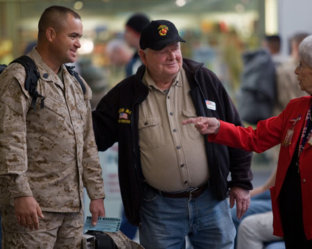 The Way We Get By: Jerry Mundy speaking with a troop and fellow troop greeter at the airport.