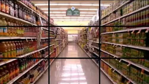 screen shot from film of grocery store aisle