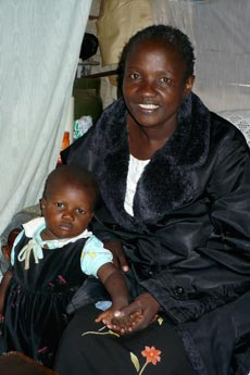 Good Fortune: Silva and her child in Kibera home
