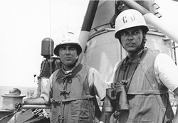 Captain John J. Herrick, USN, Commander Destroyer Division 192 (at left) and Commander Herbert L. Ogier, USN, Commanding Officer of USS Maddox (DD-731), on board Maddox on 13 August 1964. They were in charge of the ship during her engagement with three No