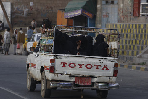 The Oath: Women in the back of a truck in Yemen