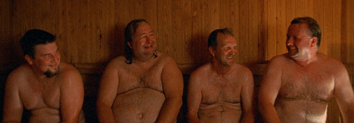 Four men enjoy a sauna