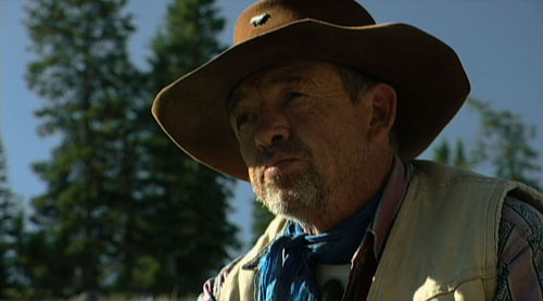 Sheep herder John Ahern looking out over a mountain in the documentary Sweetgrass