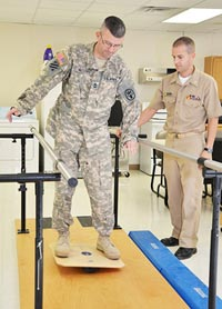 An Army Master Sgt. with moderate TBI receives therapy at the Carl R. Darnall Army Medical Center in Fort Hood, Texas.