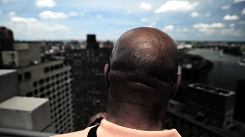 Frank on a roof in New York City